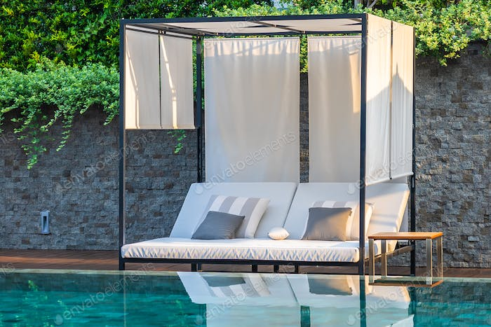 Outdoor swimming pool with umbrella chair lounge around there fo