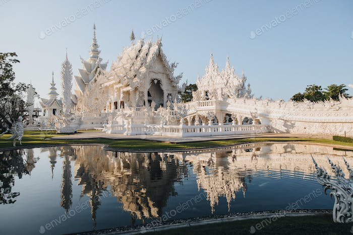 Wat Rong Khun White Temple reflected in water, Chiang Rai, Thailand