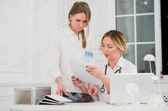 Thumbnail for Doctor and nurse looking at docments in medical office
