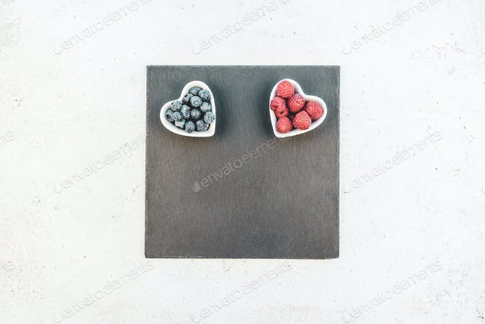 Valentine Day composition berries in heart plates