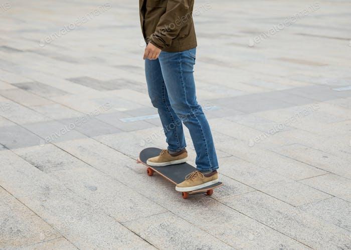 Skateboarding outdoors on sunny morning
