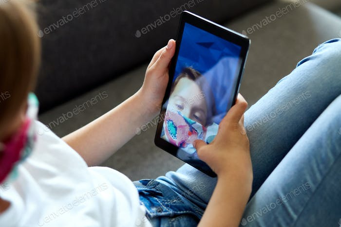 Girl with smartphone taking selfie or remote communication.