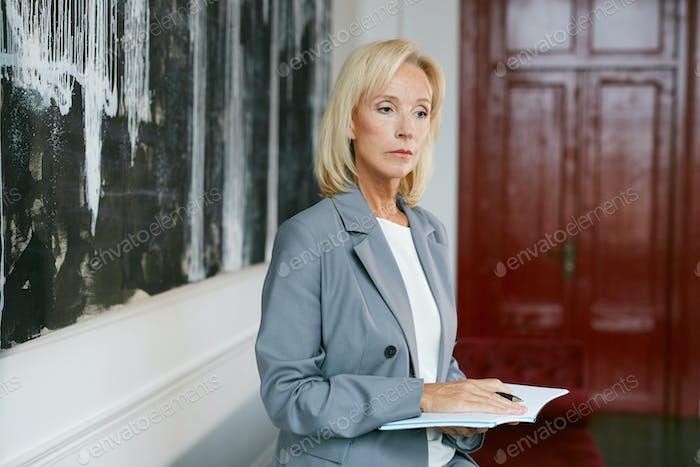 Successful Mature Businesswoman in Elegant Interior