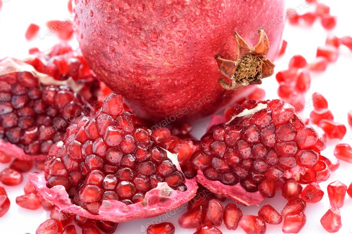 Close-up pomegranate and seeds scattered