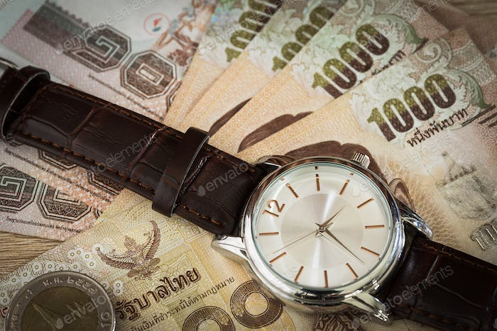 Watch and banknote