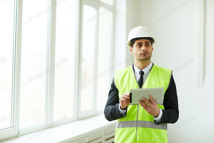 Engineer Holding Tablet