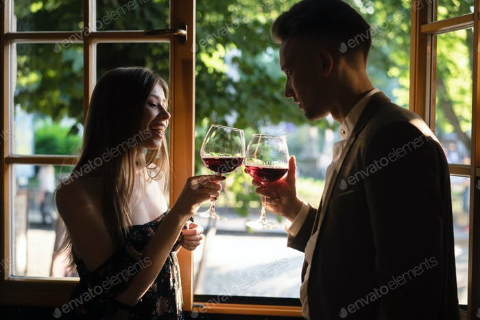 Young couple by the window