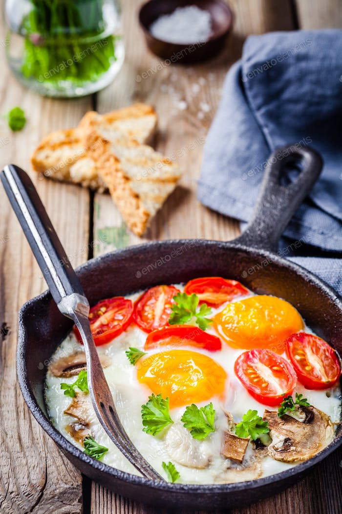 breakfast: fried eggs with tomatoes and mushrooms