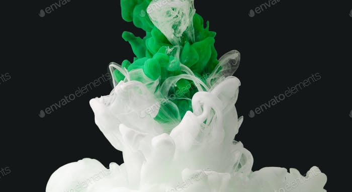 Green and white color paint drops in water