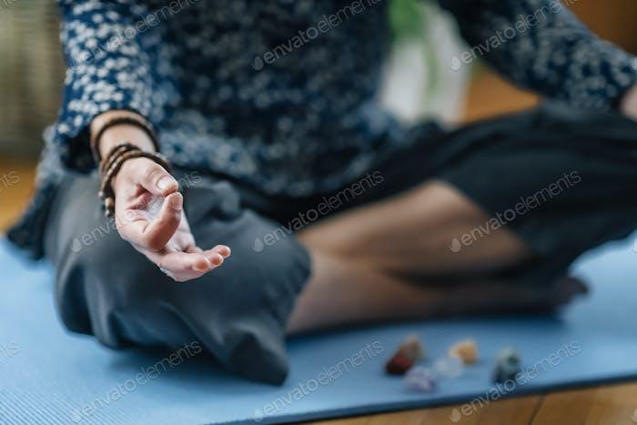 Meditating at Home. Fingers in Gyan Mudra, Symbol of Wisdom
