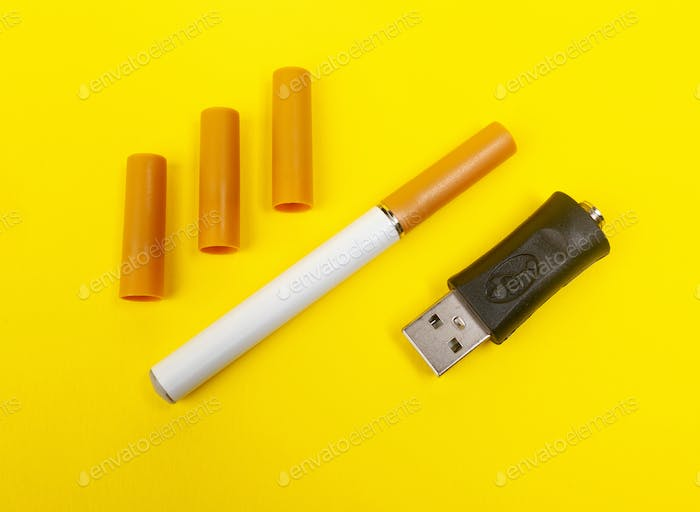 Electronic cigarette on yellow background.