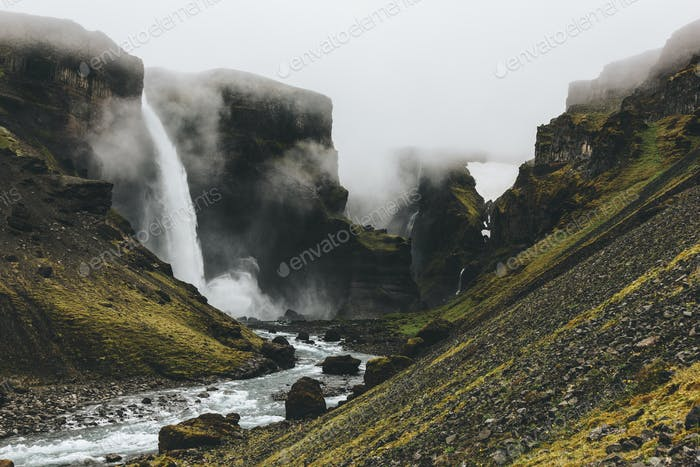 icelandic landscape with Haifoss waterfall on misty day
