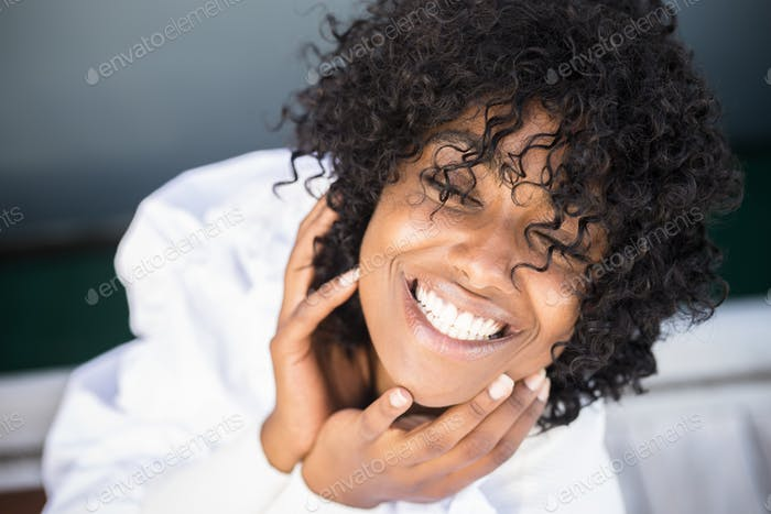 Cheerful happy young woman portrait - black african beautiful girl smile and enjoy the camera