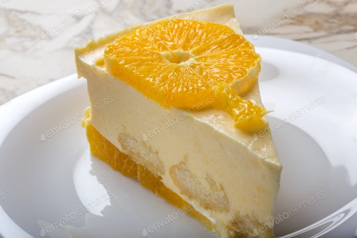 slice of homemade orange cake on plate