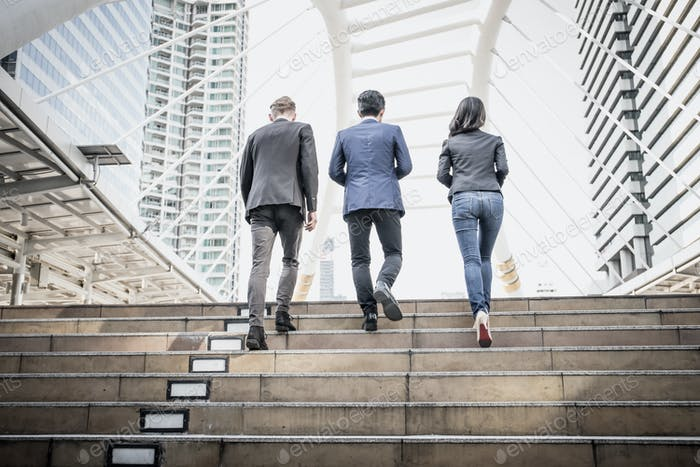 Group of Business people Walking up the stairs the way to go work.