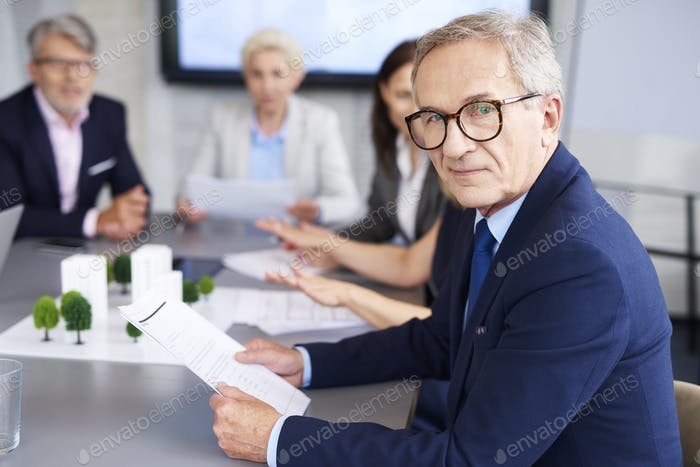 Portrait of senior businessman during a conference