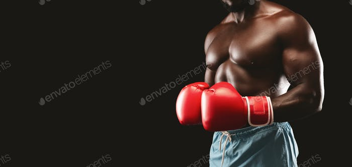 Cropped image of fighter with red gloves on