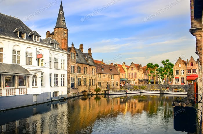 Famous water canal with colorful houses and boats in Bruges