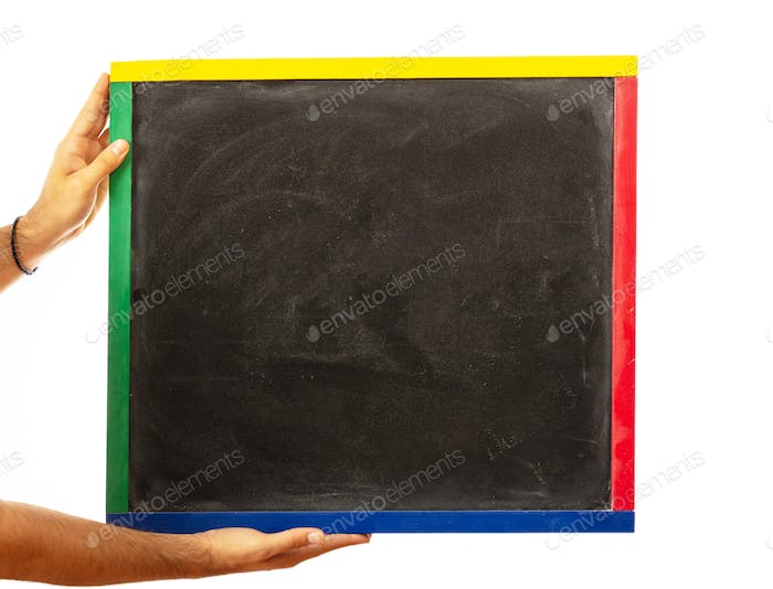 Male hands holding a blank blackboard isolated on white background, clipping path