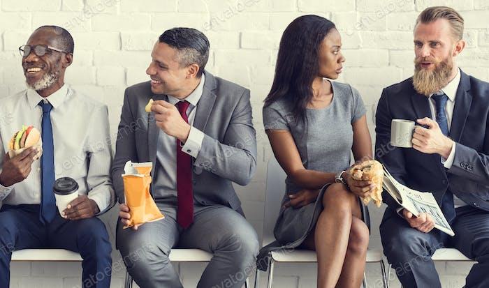 Business Team Arbeitspause Essen Mittagessen Konzept