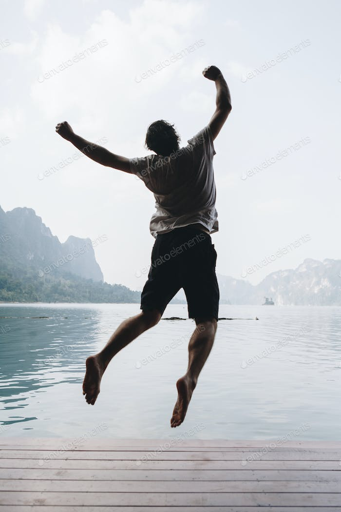 Happy man jumping with joy