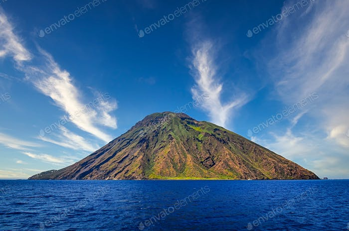 Volcanic island Stromboli in Lipari viewed from the ocean with nice clouds, Sicily