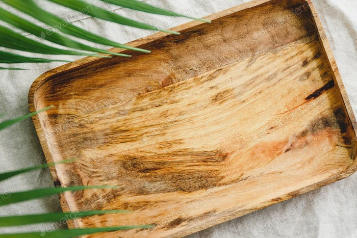Wooden tray is made from mango tree on a linen cloth