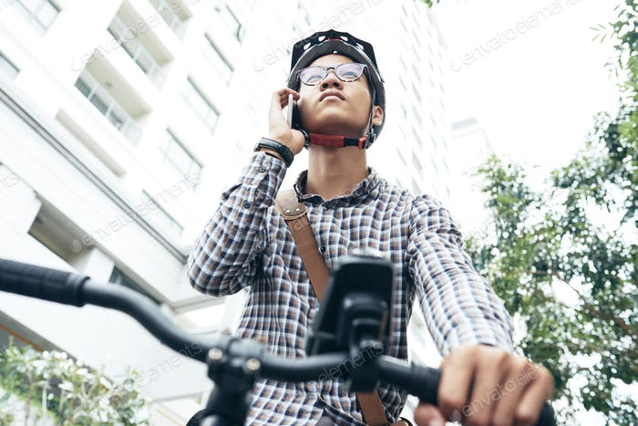 Cyclist Using Mobile Phone