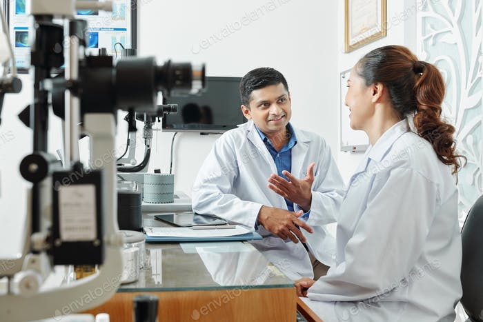 Two optometrists working in team