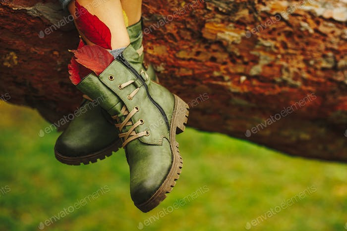Green leather boots on women legs