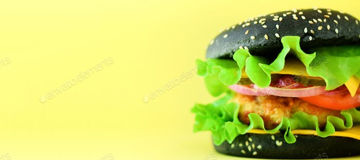 Fast food concept. Square crop. Juicy homemade hamburgers on yellow background. Take away meal