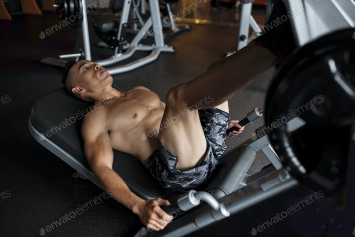 Exercising in legs press machine