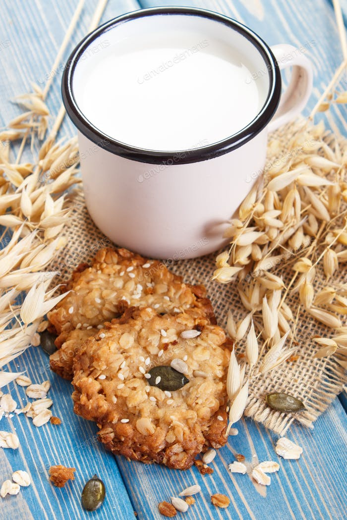 Oatmeal cookies, ingredients for baking and ears of oat, healthy dessert