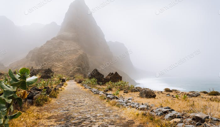 Santo Antao Island, Cape Verde. Cobbled road of Aranhas valley with impressive mountain peak. Hiking