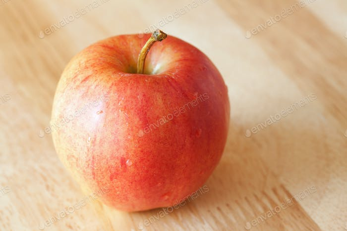 Apple on rustic wood background