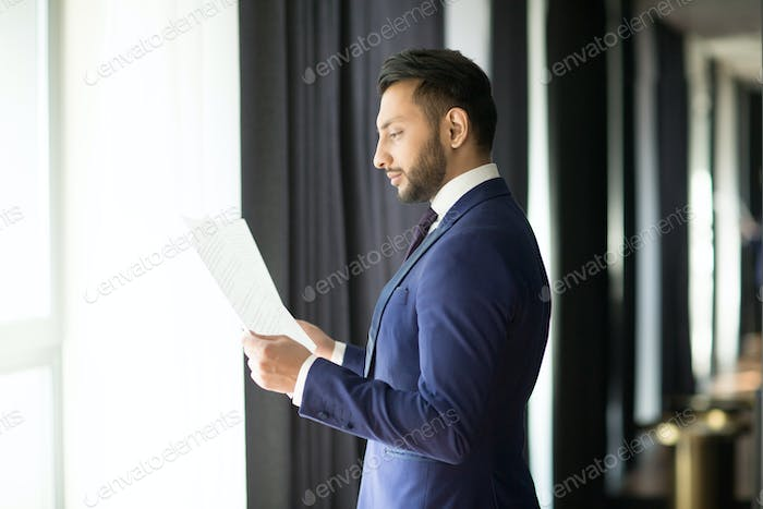 Banker reading contracts