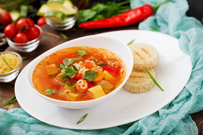 "Minestrone - ""big soup"", soup with many ingredients - a dish of Italian cuisine"