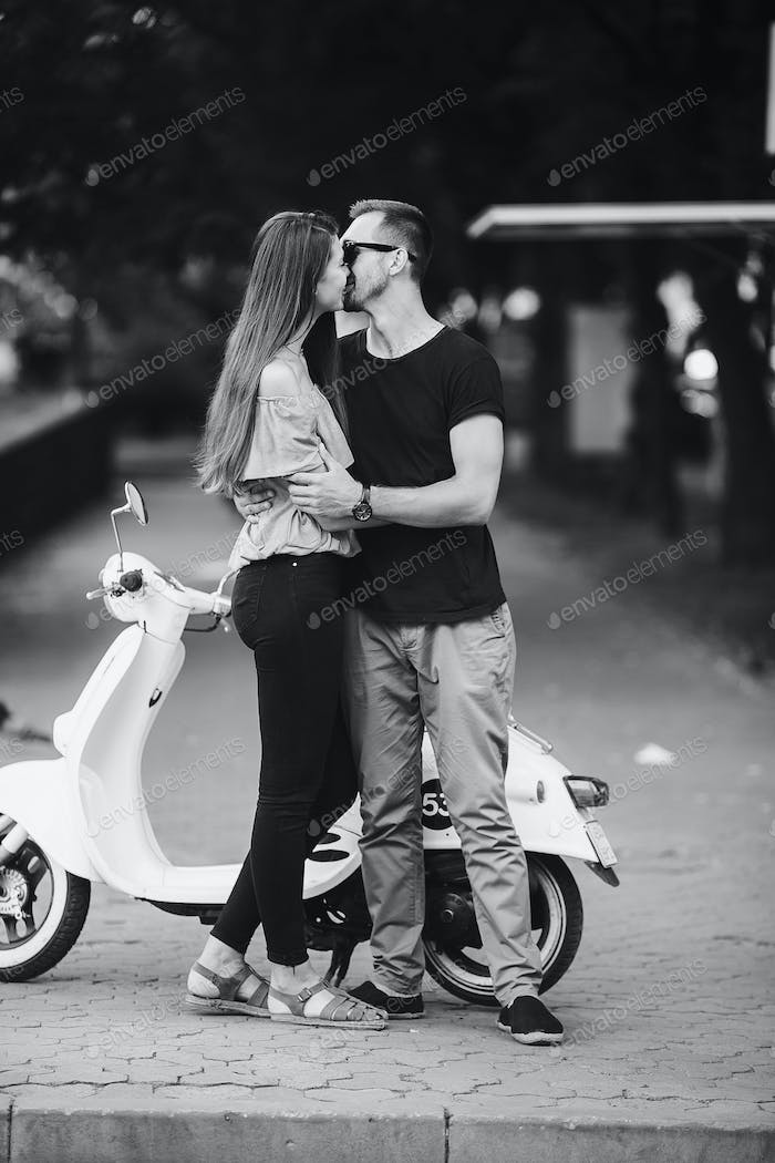 Cute couple with their scooter