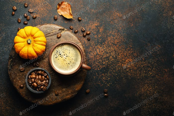 Autumn arrangement with coffee and pumpkin