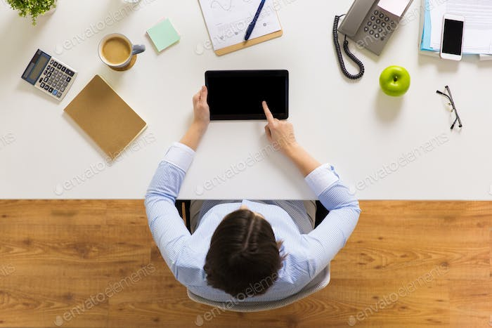 businesswoman with tablet pc at office