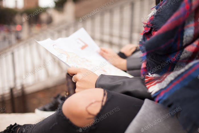 Hipster Woman Reading Map