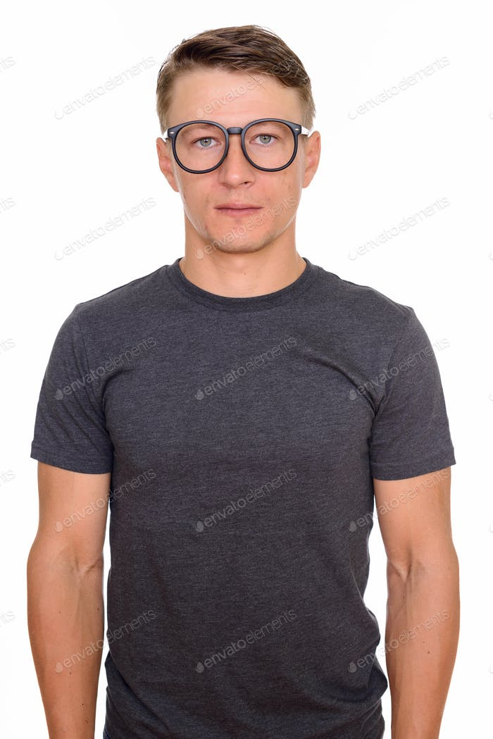 Studio shot of young handsome Caucasian man with glasses isolate