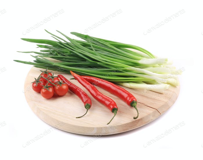 Vegetables on wooden platter.