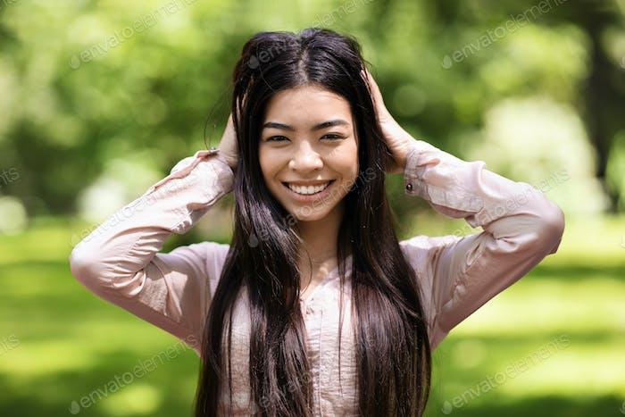 Joy Of Youth. Happy Beautiful Asian Girl Posing Outdoors In Park, Closeup