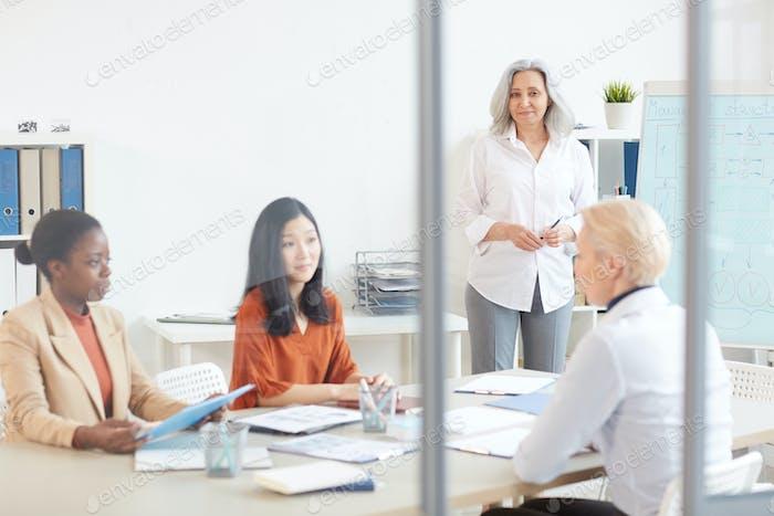 Female Team Meeting in Office