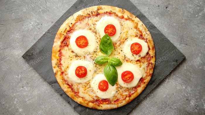 Homemade pizza with tomatoes, mozzarella