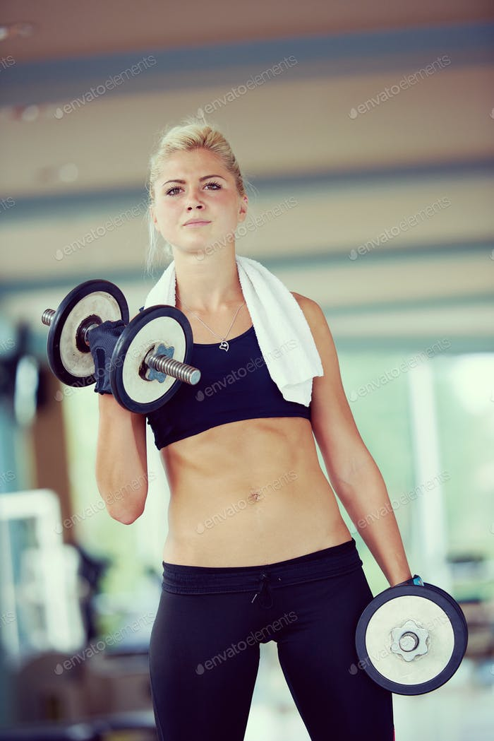 lifting some weights and working on her biceps in a gym