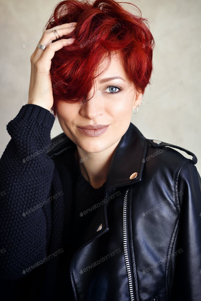 Portrait of a beautiful young red-haired woman with short hair l