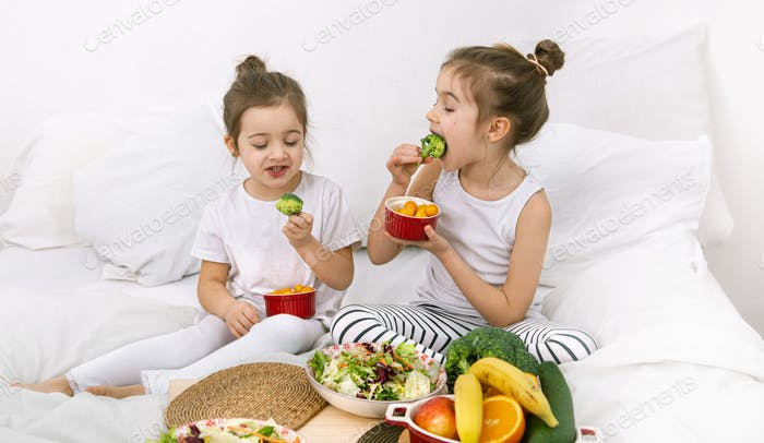 Healthy food, children eat fruits and vegetables.