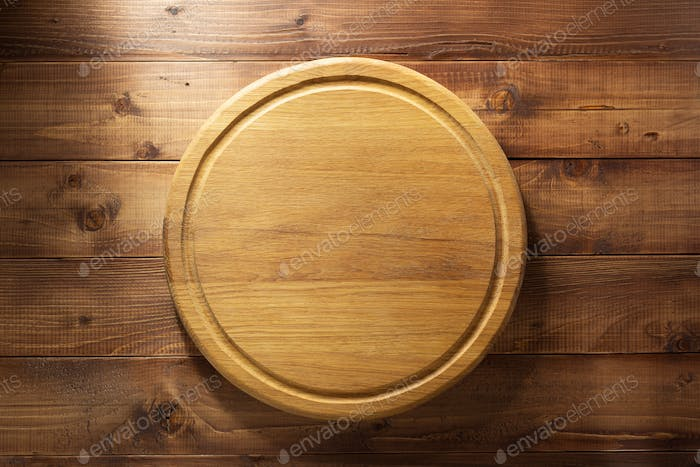cutting board at wooden background